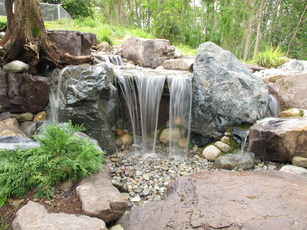 Patiozen pondless water features outsidemodern for Garden waterfalls