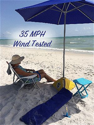 bd11c676aa Breathe Easy in the Sand: How To Secure a Beach Umbrella ...